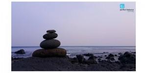 Pebbles balanced on the beach
