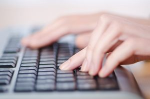 woman sending email on laptop